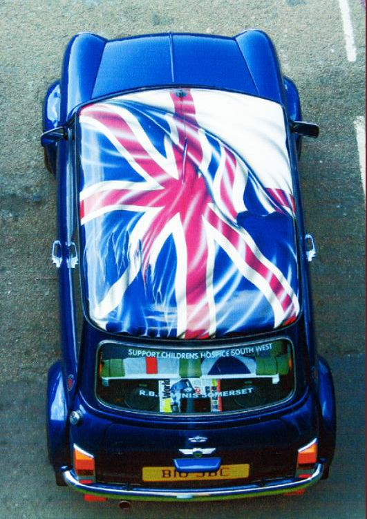Mini With Union Jack Flag. Wait, which flag is underneath? I'm guessing it's a Scottish independence Mini, but I'm not sure.