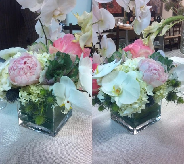 Soft pink peonies and orchids short centerpiece