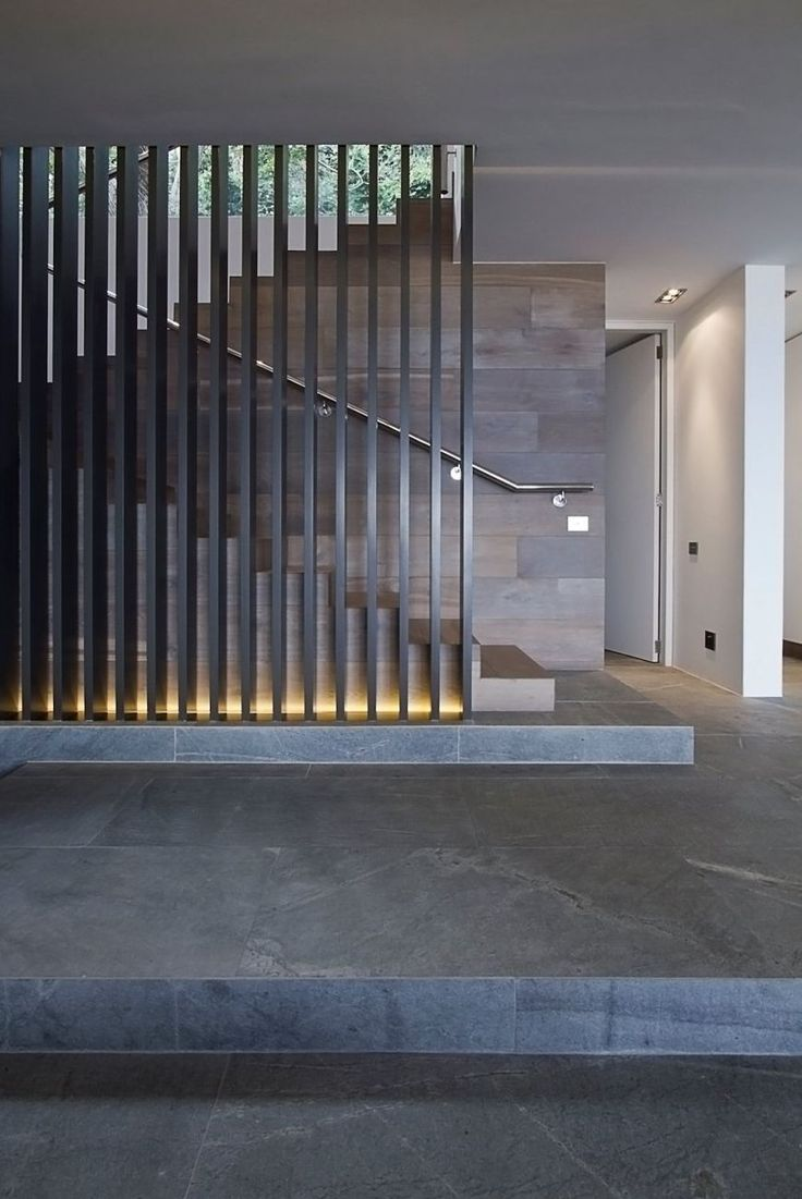 Mixture of #wood and light for this staircase #screen design