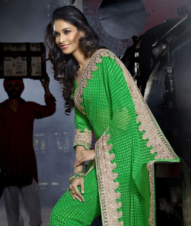 Flash your traditional side with the latest in ethnic fashion. Sarees that accentuate the modern woman's charm, come in bright hues with smooth textures and heavy motif work. Revel in this super trendy collection for dramatic glamour. BRAND: RCPCCATEGORY: Saree with Unstitched BlouseARTICLECOLOURMATERIALLENGTHSareeGreenFaux Georgette5.30 metersBlouseGreenDupion Silk0.80 meterWe would always want to send you what we showcase but there might be a slight variation in color due to photographic…