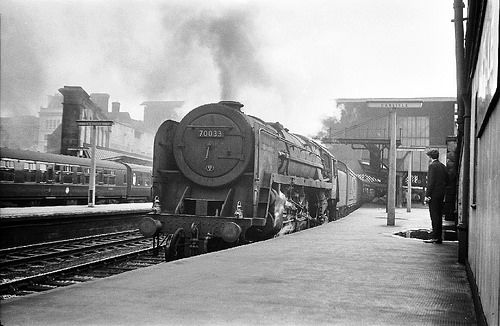 British Railways Standard Class Britannia 7P6F Pacific 4-6-2 No. 70033 'Charles Dickens' at Carlisle Citadel Station in June 1965. Designed by Robert Riddles and built at Crewe Works, it entered traffic on 13th December 1952. It was withdrawn from 68A Carlisle Kingmoor shed on 15th July 1967 and cut up by Campbells, Airdrie in 12th April 1968. The BR Standard Class 7, otherwise known as the Britannia Class, was a class of 4-6-2 Pacific steam locomotive designed by Robert Riddles for use by…