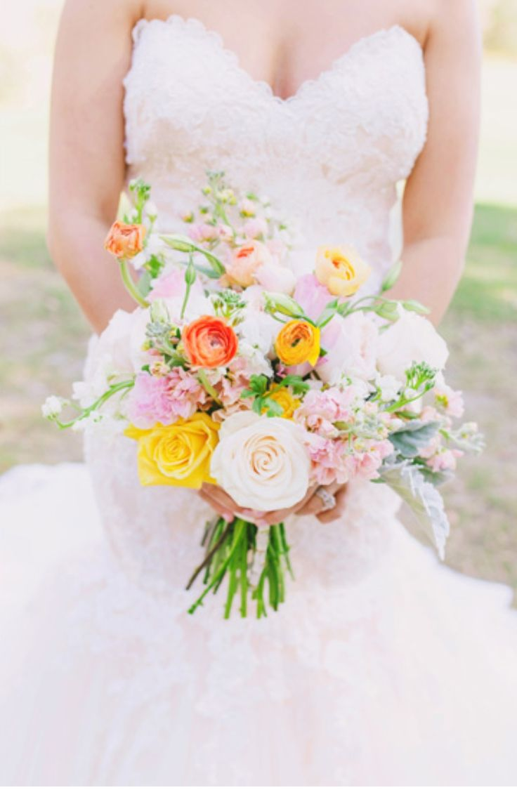 a sorbet soirée! loose bridal bouquet of kiera garden roses, peach stock, white stock, peach ranunculus, vendela roses, honey dijon roses, light pink lisianthus, lemon leaf , dusty miller & seeded eucalyptus wrapped in cream satin ribbon