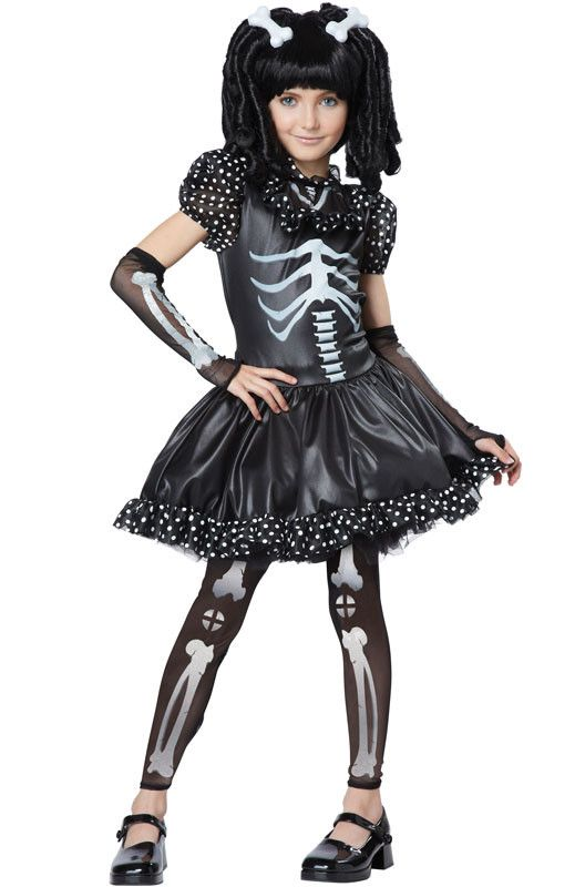 #00391 Black and white make quite a sight, the Skeleton girl costume features a dress with bone print, printed leggings, printed glovelettes and a pair of bone hair clips (2). Shoes and wig not includ