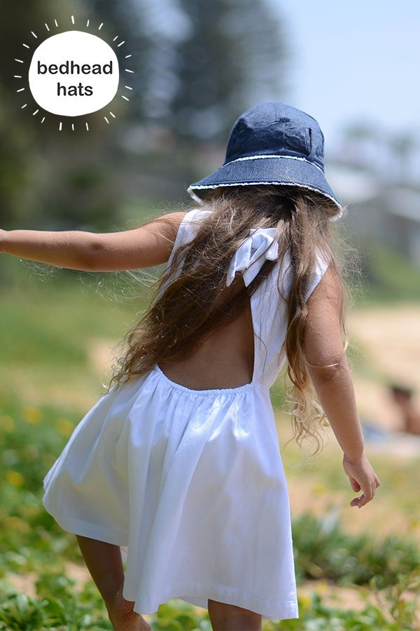 UPF50+ Girls bucket sun hat with Ponytail hole in denim with white ruffle #bedheadhats #kidshats #kidsfashion