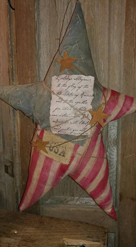 Primitive Star Patriotic star Door hanger USA July 4th Primitive flag Pledge of Allegiance Primitive patriotic door star with the pledge of allegiance Big star 23 tall x 18 wide Made of painted muslin & osnaburg with hand stitched stars. with a USA rag tag, rusty wired stars & I printed
