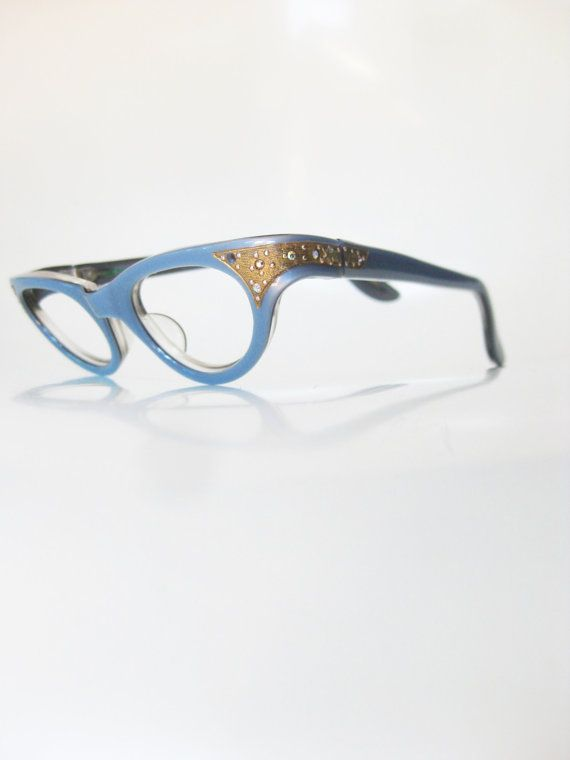 "The ""it"" cat eyes for that ""it"" girl, we are positively giddy to offer these perfectly stunning vintage 1960s light blue cat eye frames with rhinestone detail from Swan Optical (in their original branded sleeve, no less!) We've only run across these beauties once, and we feel so lucky"