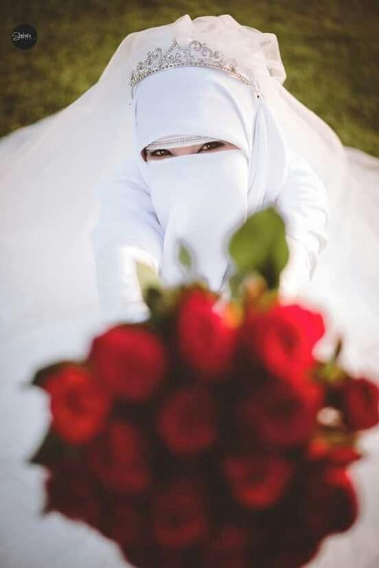 Lovely happy Niqabi bride