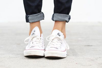 Yes, you can roll your skinnies with Converse kicks.