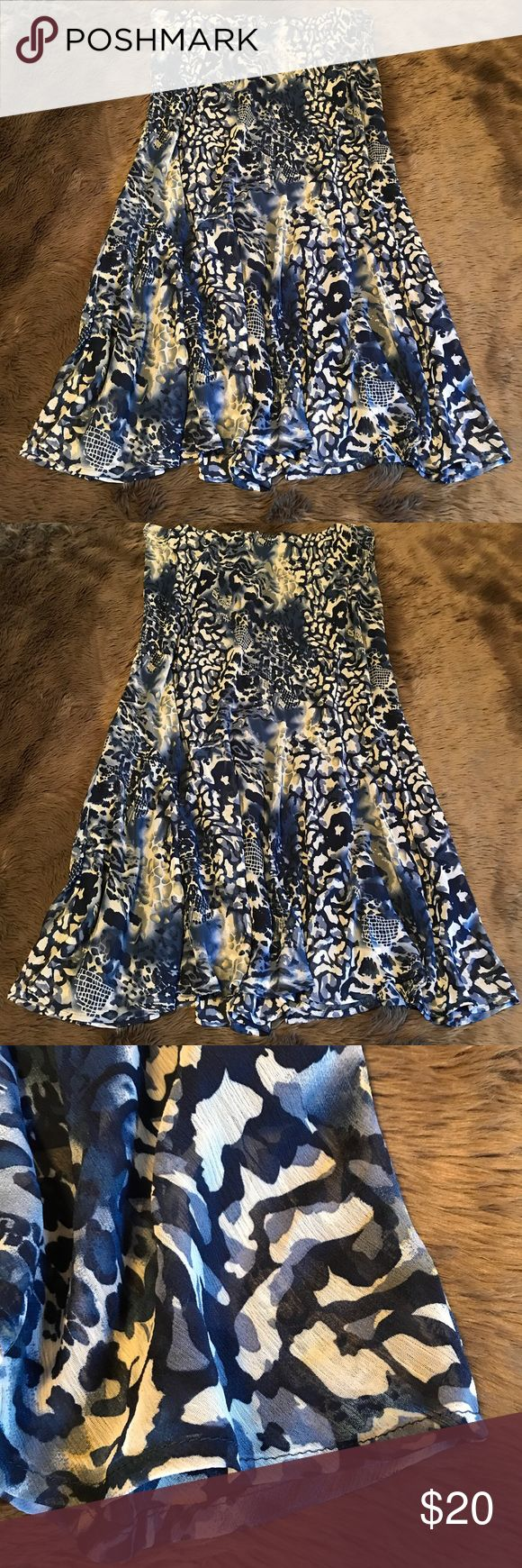 .:ASHLEY STEWART SKATER SKIRT, 24W:. Ashley Stewart skirt, size 24w. Flow he maxi style skater skirt in great condition. Zoo safari animal print pattern in bright blue and white. Skirt does have a few teeny tiny snags as pictured. They are so small I did not even notice until taking the photos! Waist band is elastic & has stretch and is not worn out at all. Happy poshing! ❤️ *plus size *career wear *wear to work *casual Ashley Stewart Skirts Circle & Skater