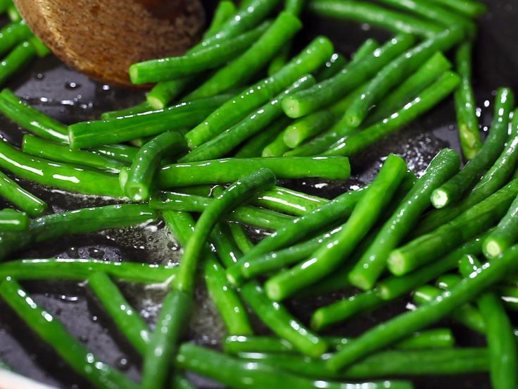 Blanching green beans involves two main steps: boiling the green beans for about two minutes, then putting them in ice water immediately after and until completely cooled.http://www.reluctantgourmet.com/how-to-blanch-foods/ When done...