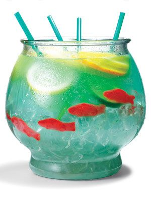 "Fish bowl! ½ cup Nerds candy, ½ gallon goldfish bow,l 5 oz. vodka, 5 oz. Malibu rum, 3 oz. blue Curacao, 6 oz. sweet-and-sour mix, 16 oz. pineapple juice, 16 oz. Sprite, 4 Swedish gummy fish, 3 slices each: lemon, lime, orange. Sprinkle Nerds on bottom of bowl as ""gravel."" Fill bowl with ice."