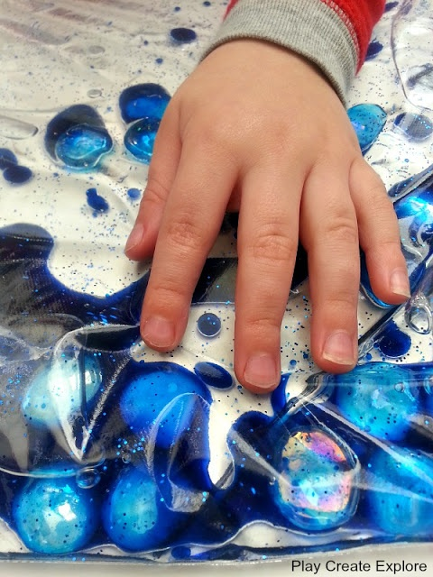 Baby Oil Sensory Bags: ziplock, baby oil, drops of food coloring, a little water, and glitter. Duct tape the seal.