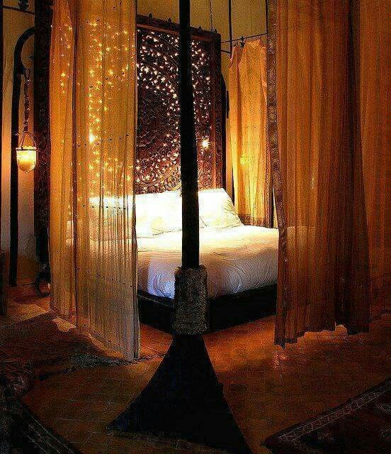 Love the long curtains and morroccan style lit headboard