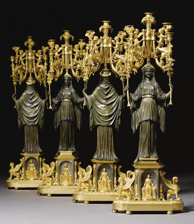 A set of four bronze and gilt-bronze seven light candelabra attributed to Claude Galle (1759-1815), Empire, circa 1810.