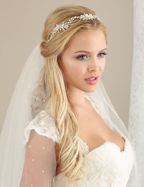We are in love with Bel Aire #6633 pearl and rhinestone headband. -Mariposa Boutique