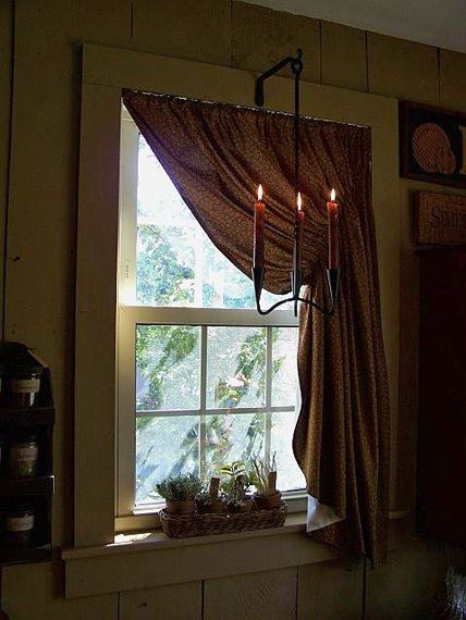 Prim curtains and rustic candlelight in the window decor ideas