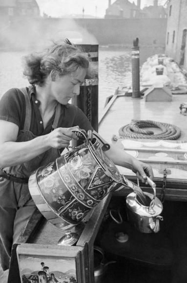 Miss March makes a cup of tea on board her narrowboat the 'HEATHER BELL' in 1942