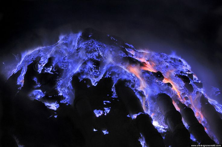 "You've heard of ""red hot"" and ""white hot"" to describe searing temperatures. But what about ""blue hot""? That's the surreal hue of Indonesia's Kawah Ijen Volcano, which glows with an otherworldly ""blue lava"" at night."