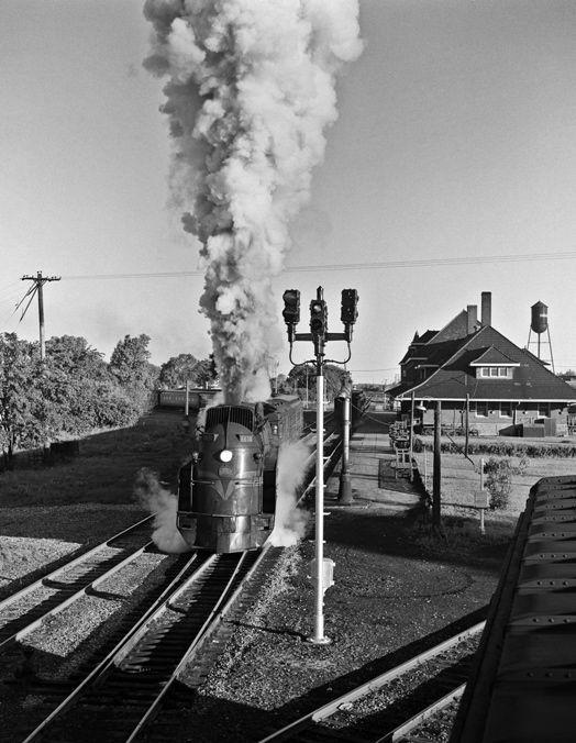 Grand Trunk Western passenger train no. 22 departing Durand, Michigan, behind steam locomotive no. 6408, a streamlined 4-8-4