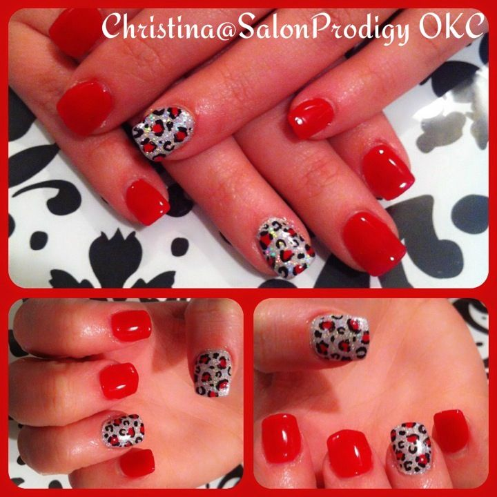 Red cheetah nail art design.