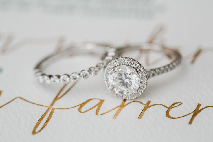 Stunning halo engagement ring: http://www.stylemepretty.com/california-weddings/santa-monica/2016/04/27/a-romantic-wedding-at-a-santa-monica-restaurant/ | Photography: Alex Warschauer - http://www.alexwphotography.com/
