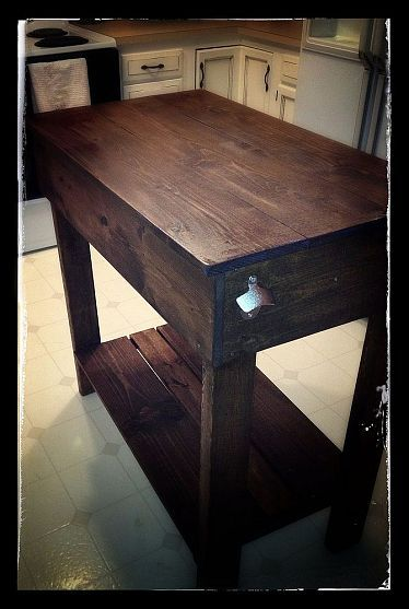DIY Kitchen Island Cart....I think we will have to make our own, with wheels. I cannot find one I like!