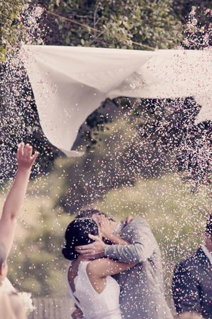 "When you say ""I do"" the wedding party pulls the ribbons and releases confetti onto the bride and groom"