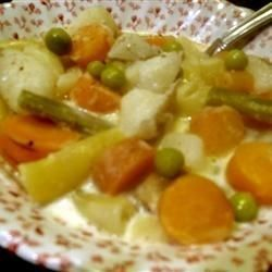 Green beans, wax beans, and new potatoes are boiled with cream in this old family recipe.