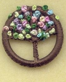 Dorset Button - The basic Blandford wheel with a variation. This one was turned into a pollarded willow tree with ribbon embroidery, to be worn as a brooch. Created by Val at the Aquarius Blog