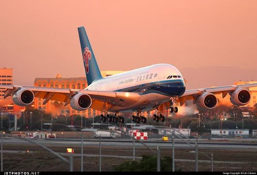 Airbus A380 China Southern landing in sunset
