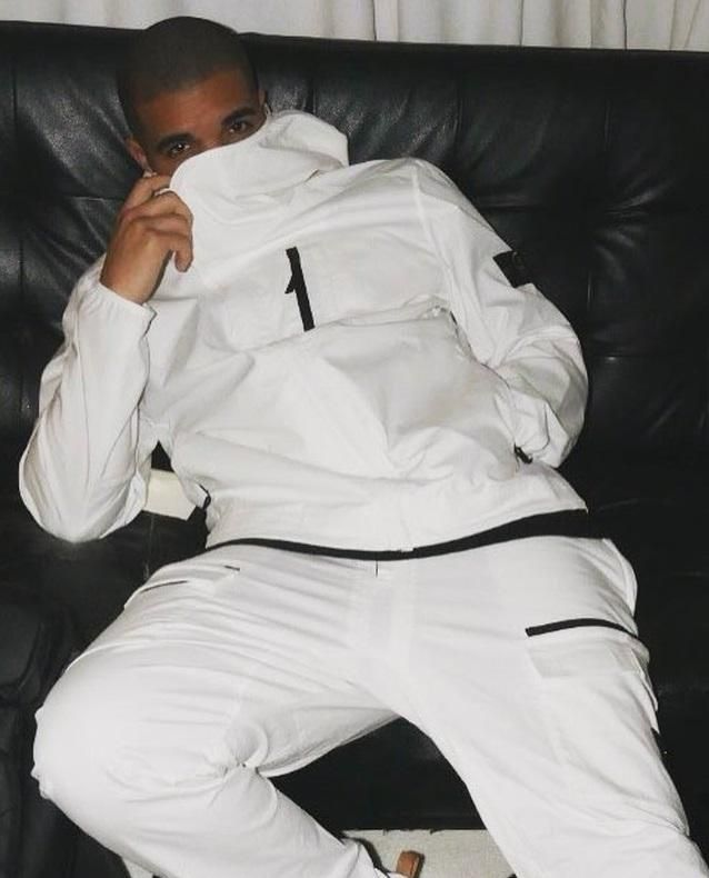 Drake's chill moment in a full Stone Island white tracksuit