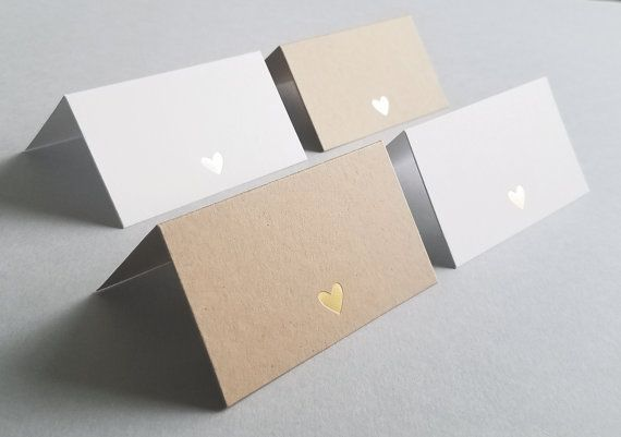 Wedding Reception Place Cards or Escort Cards with Gold or Silver Foil Stamped Heart (Set of 20) These sweet little cards are perfect for a wedding reception, rehearsal dinner, engagement party, bridal or baby shower, or any type of party. They can be used as escort cards (to guide guests to their seats), or place cards (at each individual place setting). The cards are left blank for you, or your calligrapher, to add the names of your guests and any other needed information (such as table…