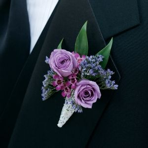Groom and groomsmen boutonniere. It actually won't look anything like this, lol, but these are the colors......