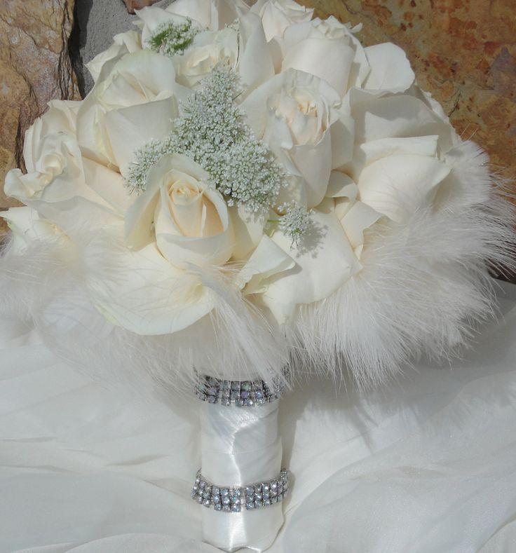 Feathers incorporated into your floral bouquet is very chic this year./ SANDRA & VERONICA WEDDING PLANNERS