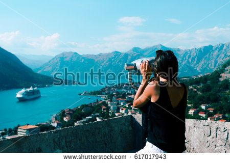 Girl looking panorama of the Perast in Boka Kotor Bay, Montenegro, Balkans