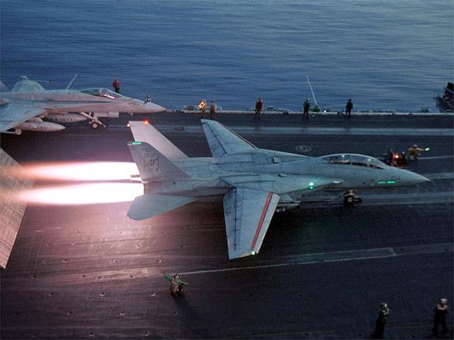 F-14 Tomcat using afterburners for take off. The original  Pratt & Whitney TF30 engines were replaced with GE F100's not requiring afterburners to be used on take off.