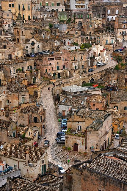 Strada tra i Sassi, Matera, Italy. I know it looks beautiful to you, but certainly the luxury of living in these place takes a huge amount of money. Better be off with a modern house!