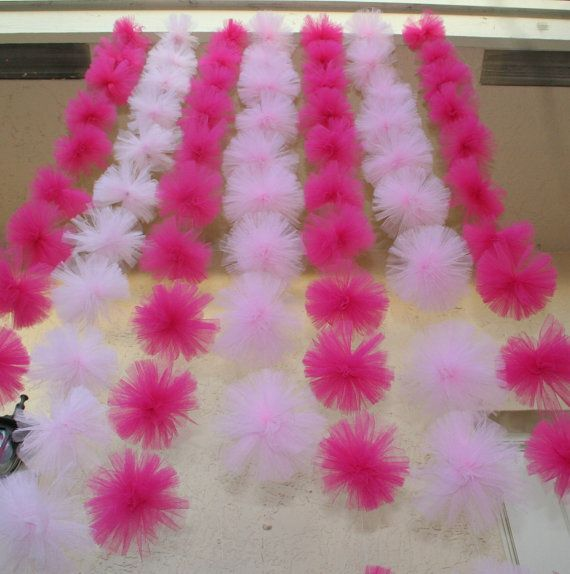 tulle pom pom garland... Ooh! I could do this across her spindles on her canopy bed!