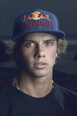 Julian Wilson. I'd make the effort to learn how to surf if this dude was teaching me..