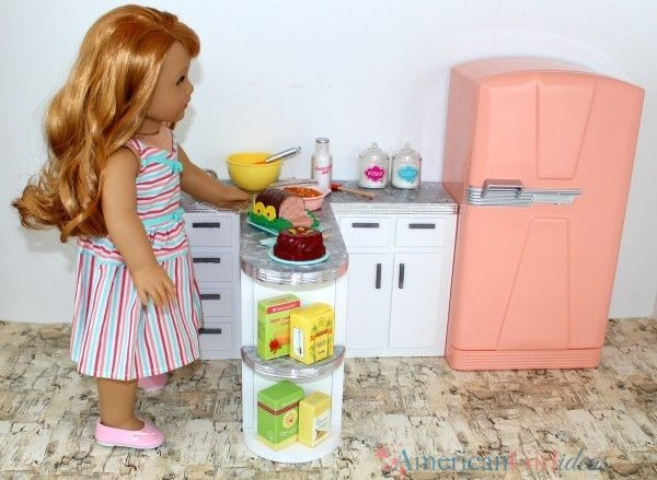 American Girl Doll Kitchen Counter DIY American Girl put together a Maryellen scene with an adorable kitchen counter. It had her cookie cutter set in it and her retro fridge. I loved it! They always put together great scenes for their website and catalogues using pieces that they don't sell and we take notice! A …