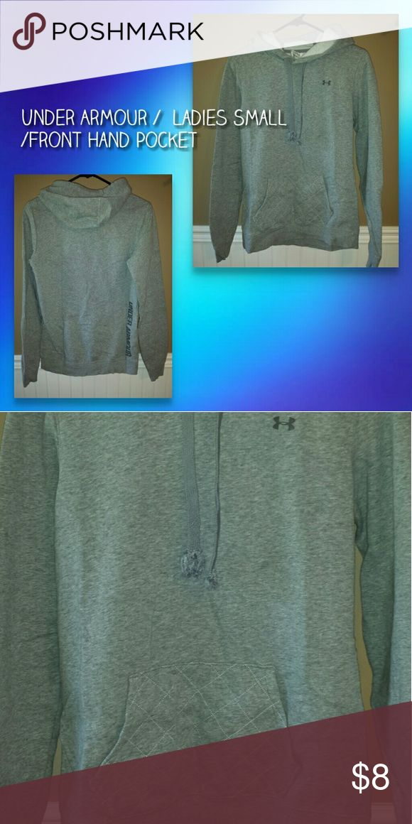 UNDER  ARMOUR GREY HOODIE UNDER ARMOUR HOODIE WITH FRONT HAND POCKET* IT DOES HAVE SOME WEAR SUCH AS DRAWSTRING IS FRAYED & A FAINT STAIN ON FRONT ,  OTHER THAN THAT IN GREAT CONDITION * LADIES SMALL AND CAN FIT GIRLS SIZE 10/12 Under Armour Shirts & Tops Sweatshirts & Hoodies