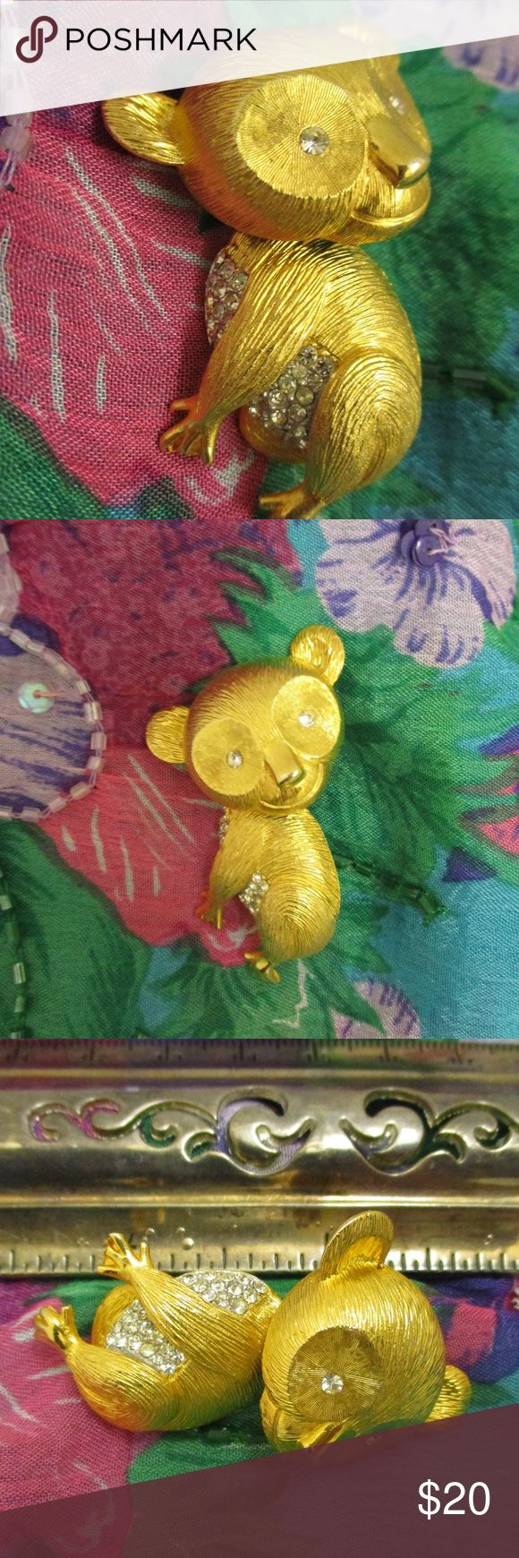 "Rhinestone Gold Koala Bear Trembler Nodder Brooch Darling vintage textured gold tone and pave set clear rhinestone Aussie Koala Bear trembler en tremblant nodder brooch. This cute critter has a chest and tummy full of sparkling clear faceted rhinestones with two additional rhinestones for the eyes. Gold texture resembles fur with areas of smooth gold on nose and paws.  His darling head is on a spring and trembles, shakes and shudders with every movement. Just precious!!  2"" x 1 1/2"" x @ 3/4""…"