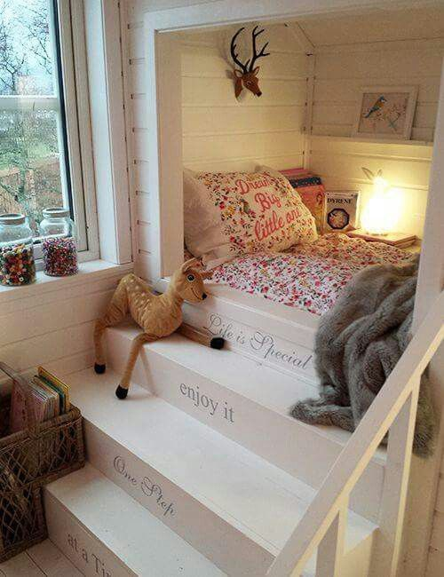 Cute childs bed with steps. Looks cozy.