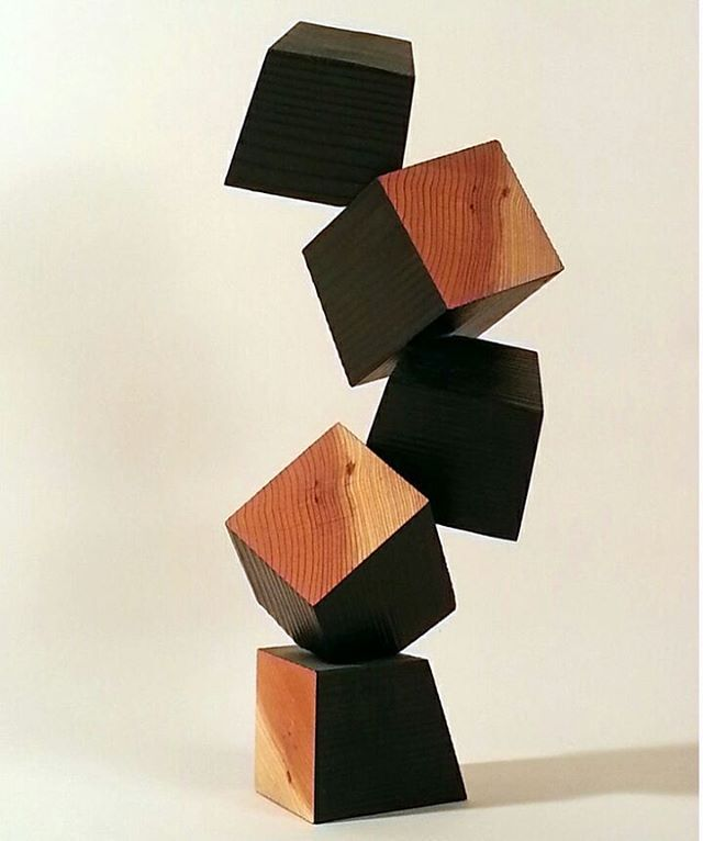 "5 Cubes, burnt and natural wood, 17"" x 7"" x 8""  This was my first work in a series that explores the expressive potentials of a most rudimentary form, the cube. 4 x 4 Redwood lumber was burned and cut into blocks to reveal the woods inner warmth.  #sculpture #carving #woodcarving #chainsawcarving #lumber #deanramos #losangelesart #sandiegoart #minimalism #contemporaryart #modernart #cube #abstract #art #architecture #contemporaryartist #wood #tower"