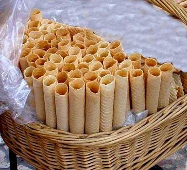 Barquillos are thin rolled cookies of Spanish origin. In the Philippines, Iloilo is particularly known for its barquillos. They are made by pouring a thin batter is onto a wafer iron (barquillera). Once the wafer is cooked to a light brown it is immediately rolled while still hot. It becomes a crisp rolled cookie when it cools.