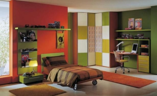 Elegant Study Table For Modern Teen Bedroom Interior Design Ideas: Exotic Kids Room For Boy With Wooden Study Table Design Plus Swivel Chairs Beside Orange Rug Also Colorful Wardrobe And Orange Green Paint Wall Also Brown Bed Cover Trundle Bed ~ justsoakit.com Bedroom Inspiration