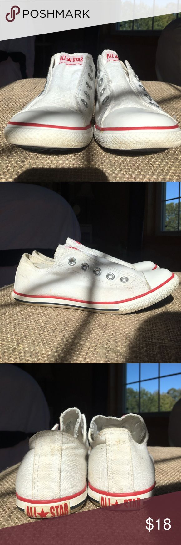 Converse slip on All Star sneakers 👟 Converse All Star sneakers. Lace-free by design, these slip on sneakers are the perfect casual by stylish twist any time of year. They are white with red detailing around the soles. These sneaks have been used lightly and have some slight areas where the white isn't as vibrant due to normal wear around grass/dirt as seen in photos. Still have so much life left in them! Converse Shoes Sneakers
