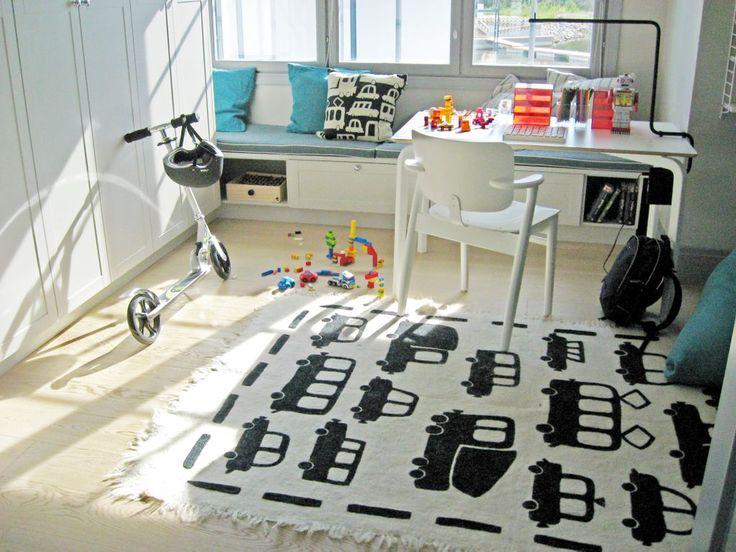 TIKAU Brum Brum felted carpet & cushion cover at Housing Fair Finland, Kokkola 2011. Kannustalo Aarre, http://www.asuntomessut.fi/kokkola-2011/kannustalon-aarre