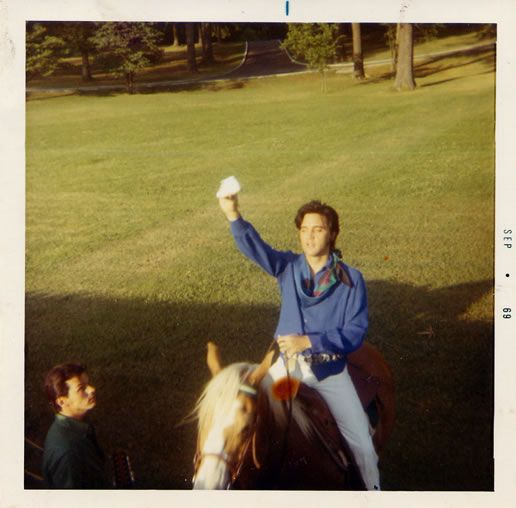 Elvis on Rising Sun at Graceland, circa May-June 1969.
