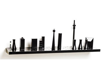Jozi Shelf by Egg Designs. The bookends, which can move around the shelf in any configuration, are Marquette's of all the most recognisable buildings dotting the Gauteng skyline.